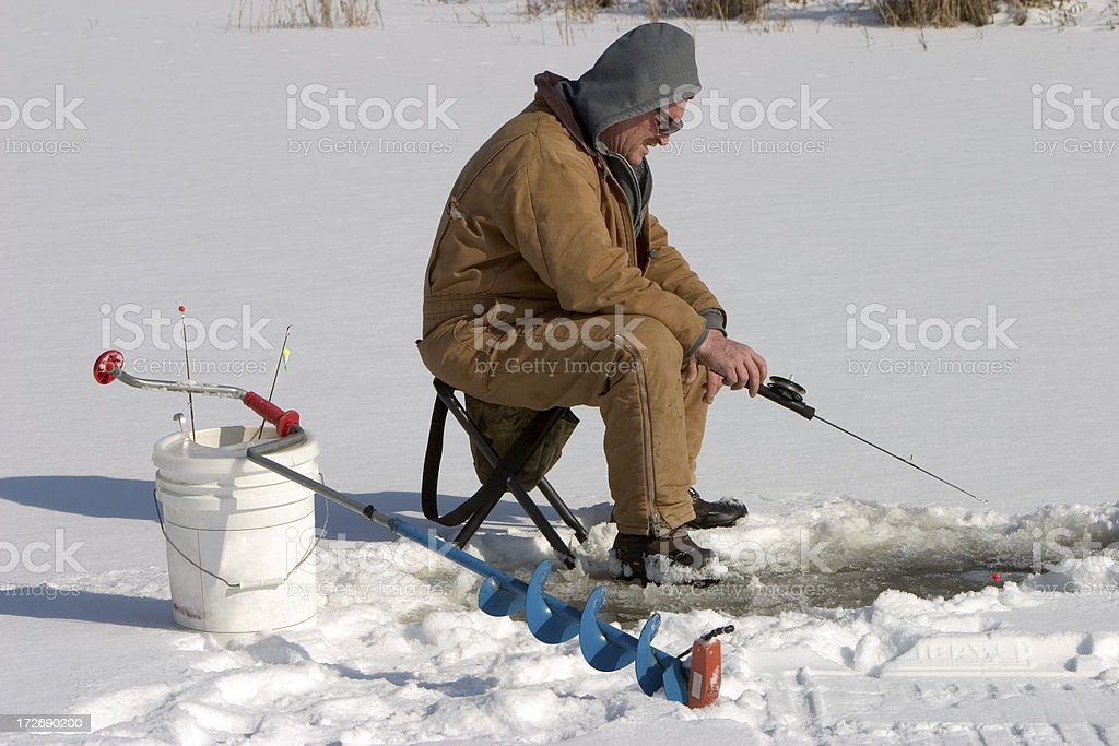 Fishing Through the Ice royalty-free stock photo