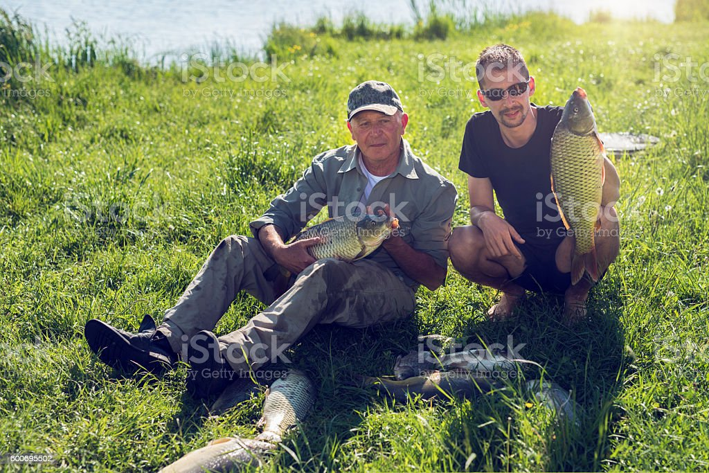 fishing time with my father stock photo