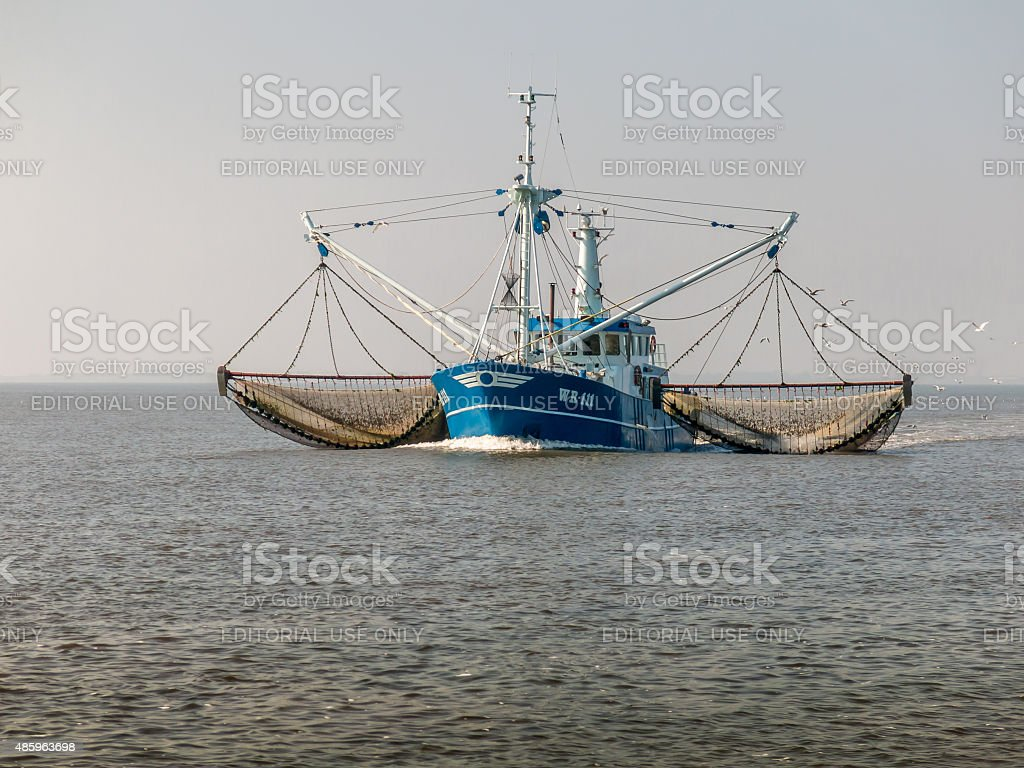 Fishing trawler at sea, Netherlands stock photo