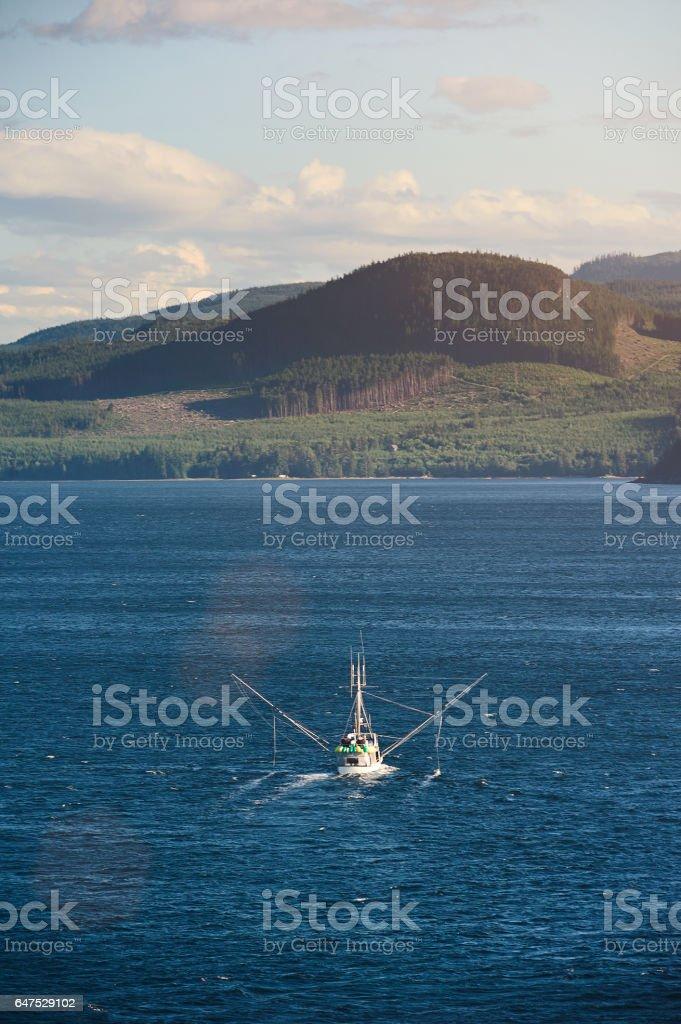 Fishing trawler at sea stock photo
