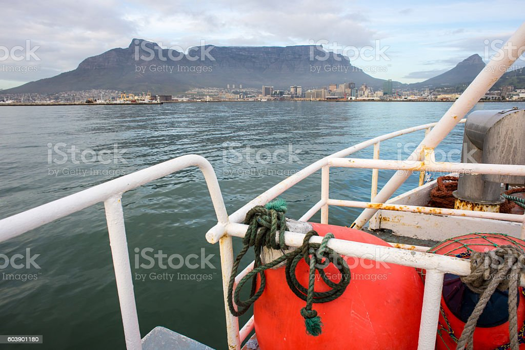 Fishing Trawler in front of Table Mountain stock photo