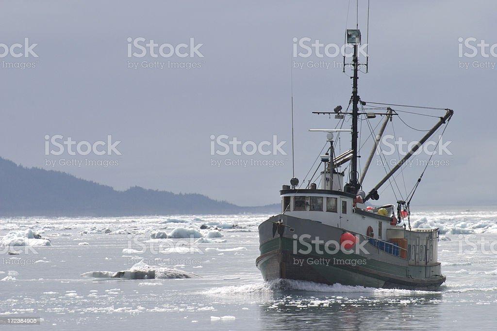 Fishing Trawler in Ice Filled Alaskan Water stock photo
