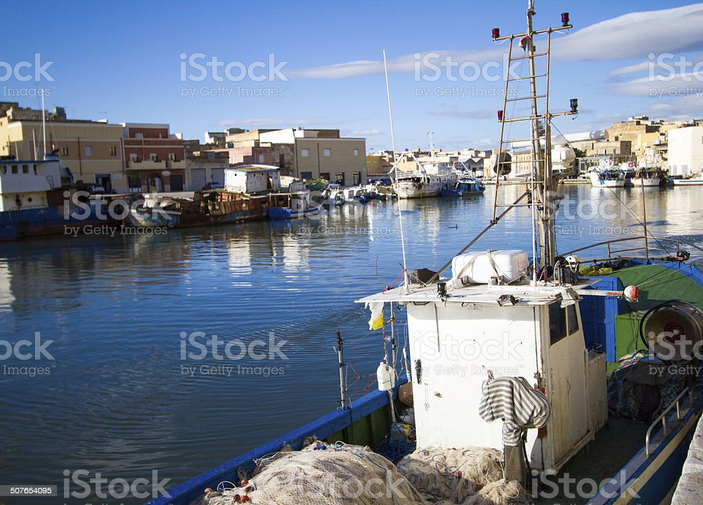 Fishing Trawler in Mediterranean Port, Backdropped by Blue Sky stock photo