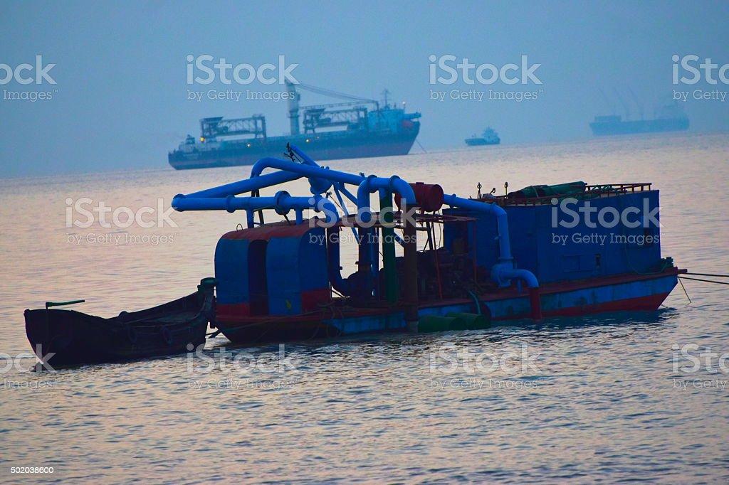 Fishing trawler on the seawater - stock image stock photo