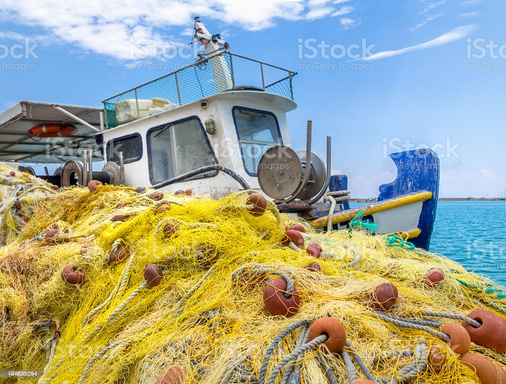 Fishing trawler tied up to the dock stock photo