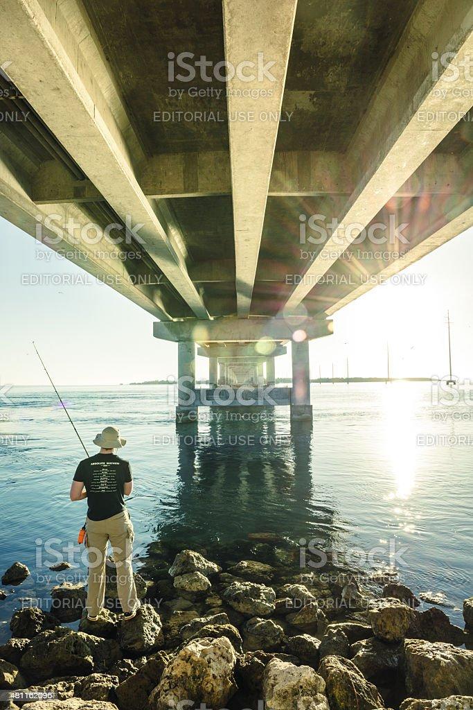 Fishing under Overseas highway in Florida Keys stock photo