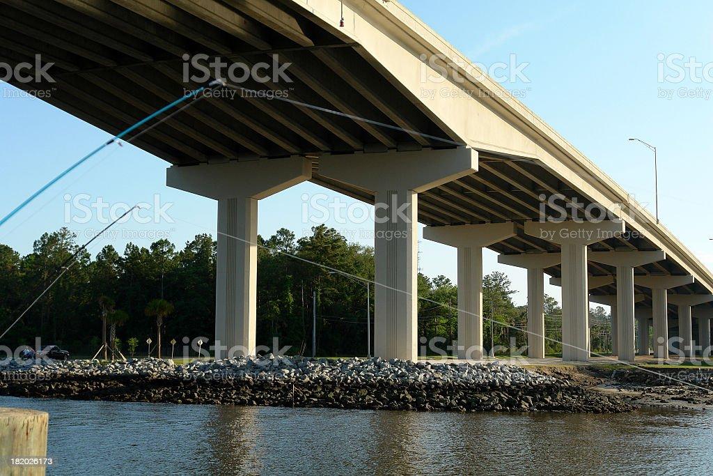Fishing under the bridge royalty-free stock photo