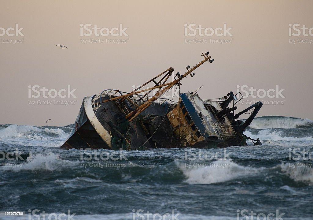 Fishing vessel boat aground on sea stock photo