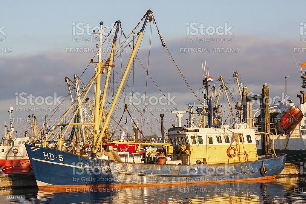 fishing vessel in the last warm sunlight stock photo
