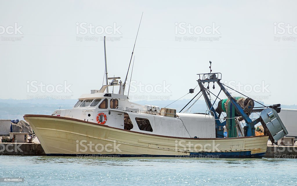 Fishing vessel in the port. stock photo
