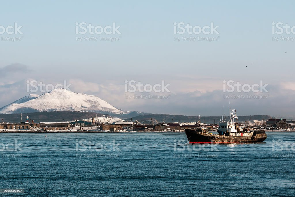 fishing vessel on the background of winter stock photo
