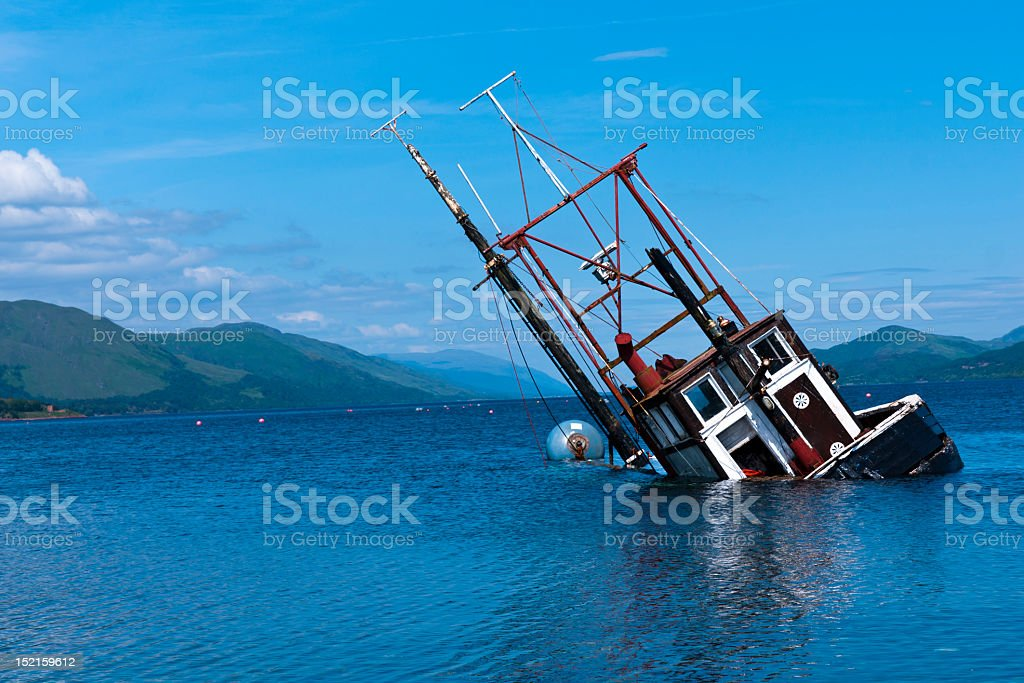 Fishing vessel partially submerged in Loch Linnie Lake stock photo