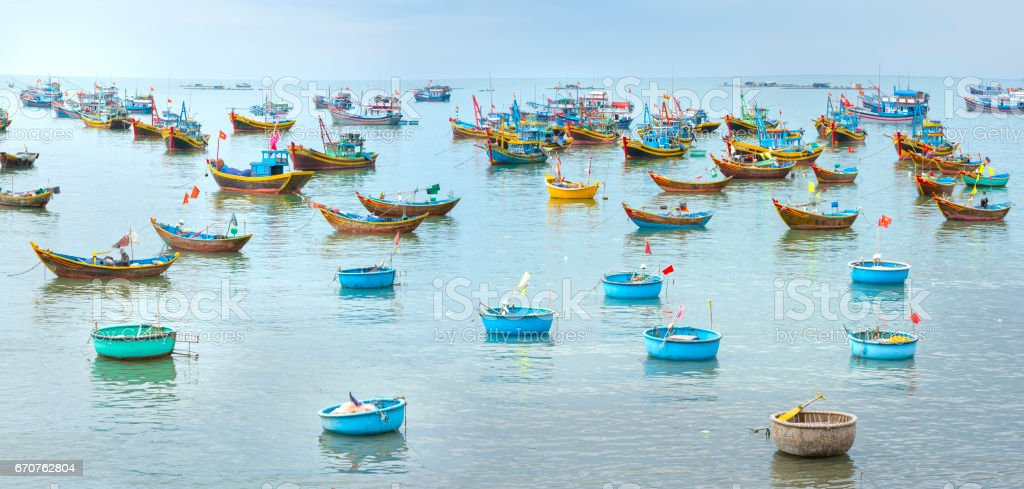 Fishing village and traditional Vietnamese fishing boats stock photo