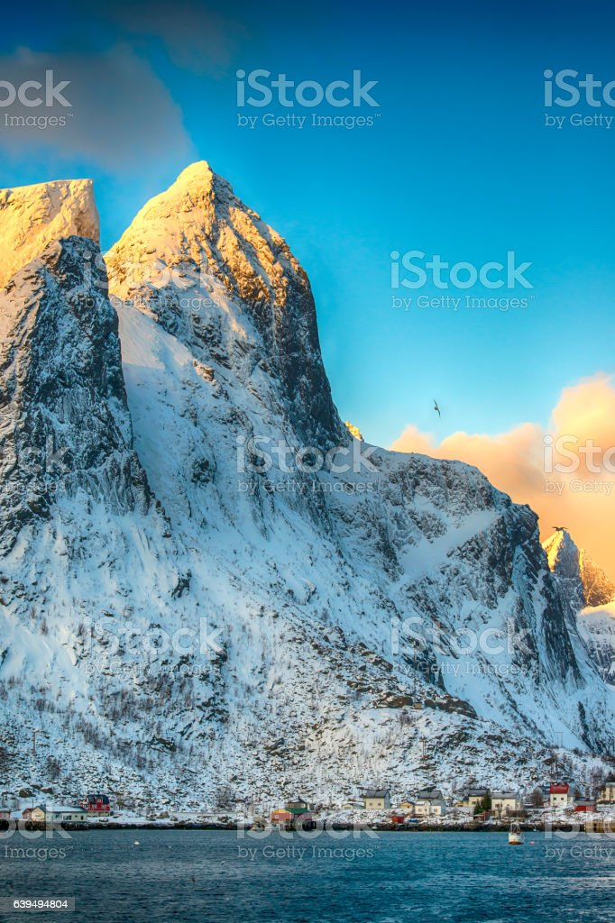 Fishing village in front of the mountains, Lofoten islands, Norway stock photo