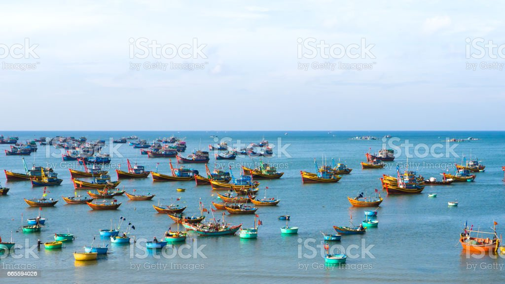 Fishing village landscape scene blue water background stock photo