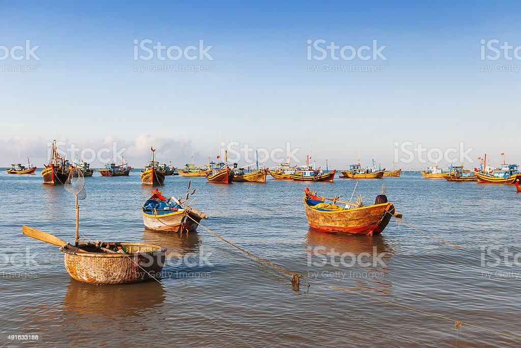 Fishing village, market and colorful traditional fishing boats stock photo