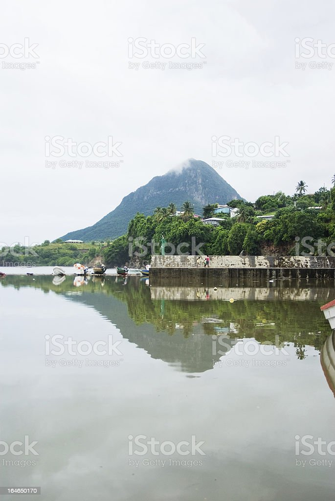 fishing village mountain landscape reflected in water stock photo