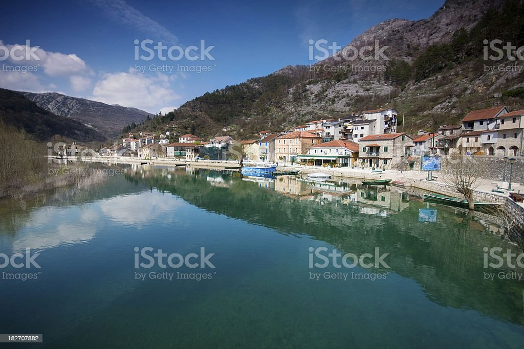 Fishing village on lake with chrystal clear water stock photo
