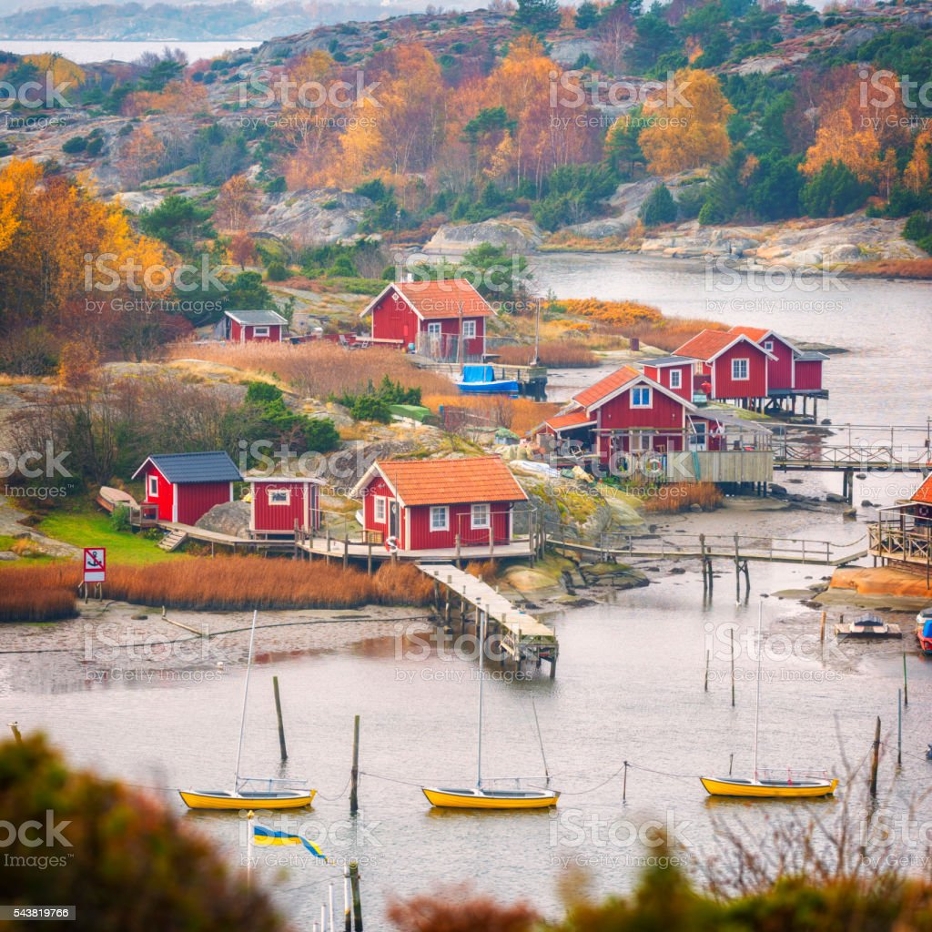 Fishing village with small red cabins stock photo