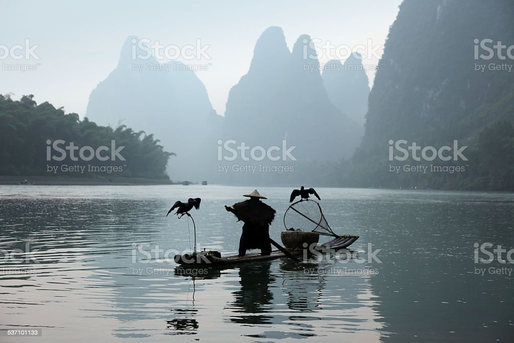 Fishing with cormorants birds in Yangshuo stock photo