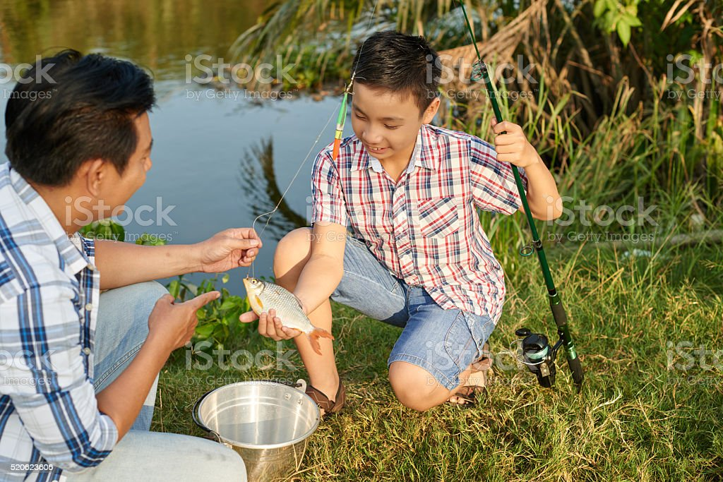 Fishing with father stock photo