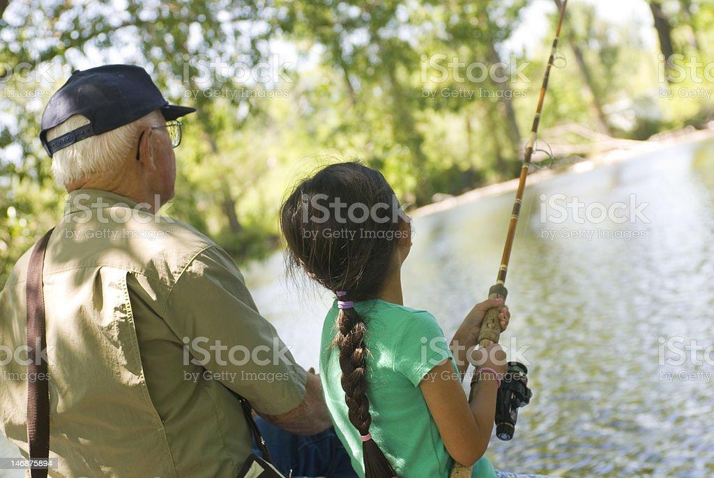 Fishing with Grandpa stock photo