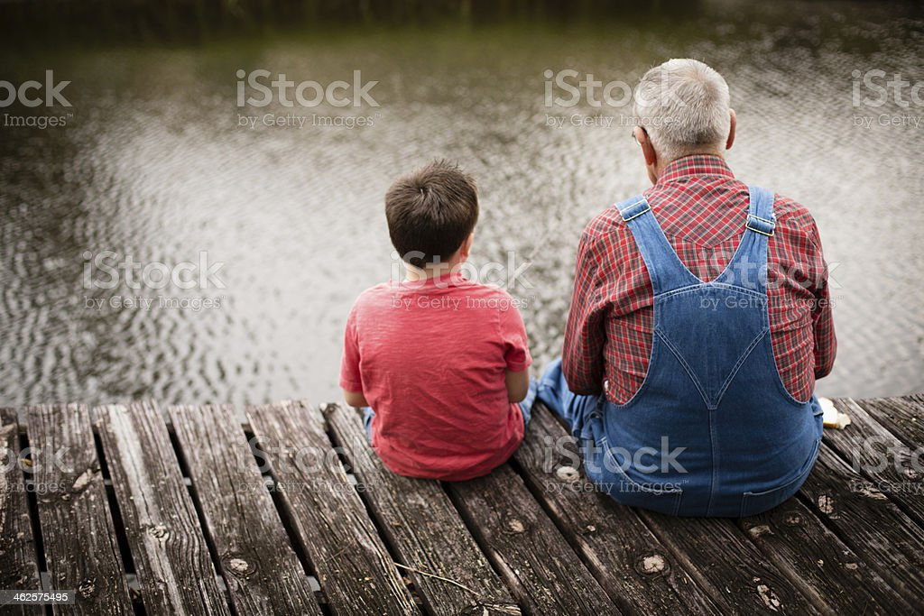 Fishing With Grandpa, Rear View stock photo