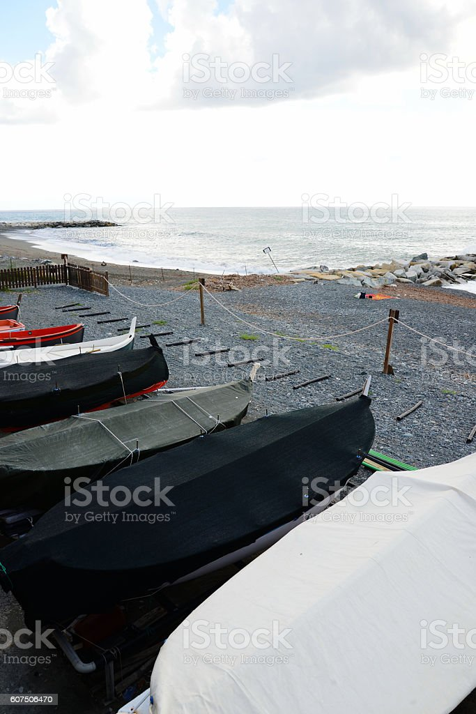 fishing wooden boat moored on the beach stock photo