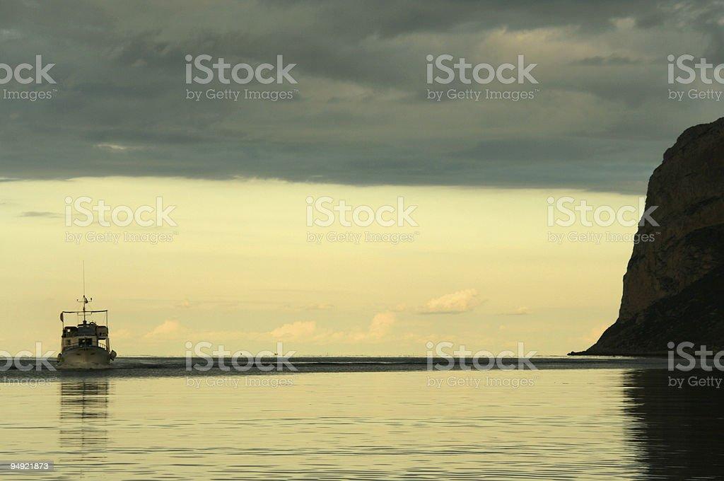 fishingboat heading home royalty-free stock photo