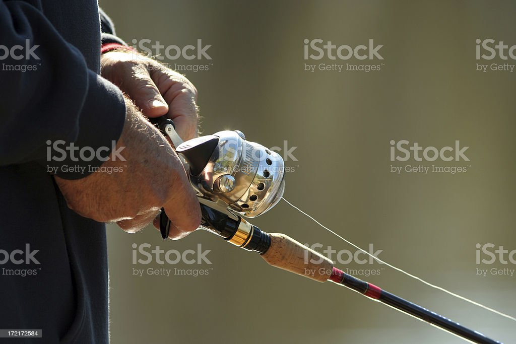 Fishing-Closeup Hand with Rod and Reel royalty-free stock photo