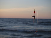 fishing-rod with bait