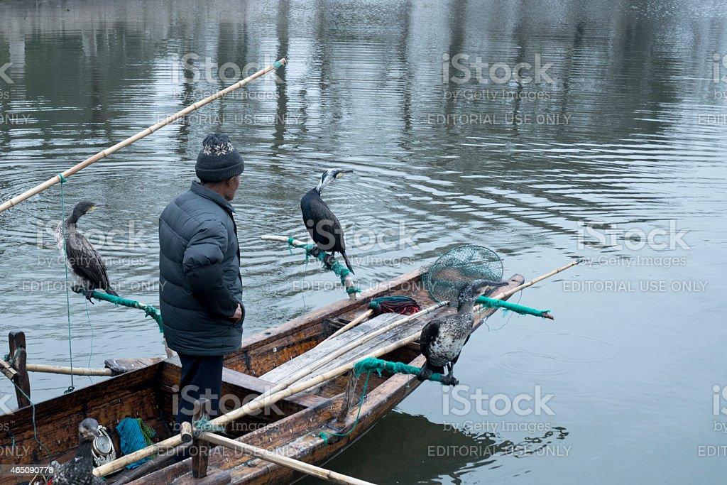 JINXI, SHANGHAI, CHINA FEB 21: fishman and his osprey. stock photo