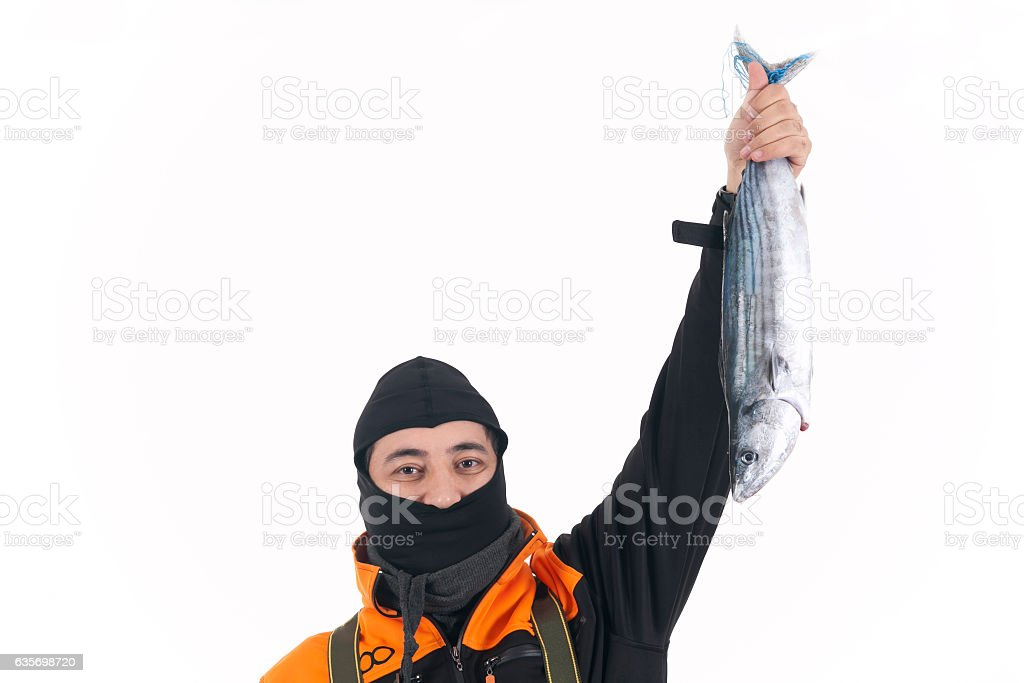 Fishmerman holding fresh fish in studio stock photo