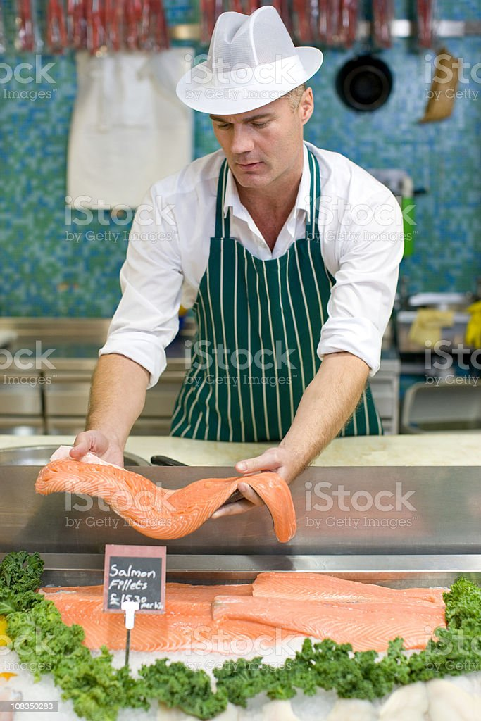 Fishmonger holding salmon fillet stock photo