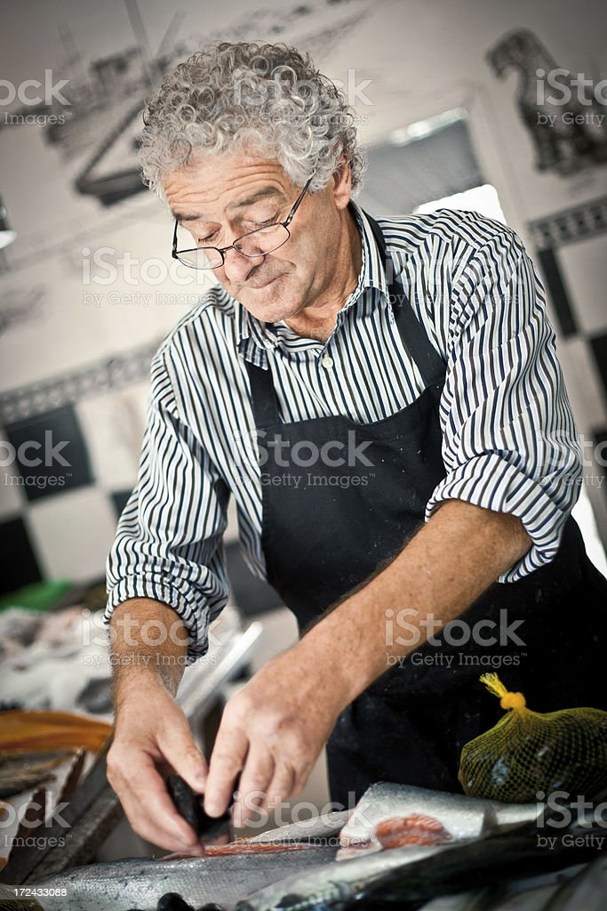 Fishmonger in his shop royalty-free stock photo