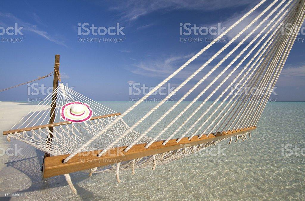 Fishnet hammock on a paradisiac beach royalty-free stock photo
