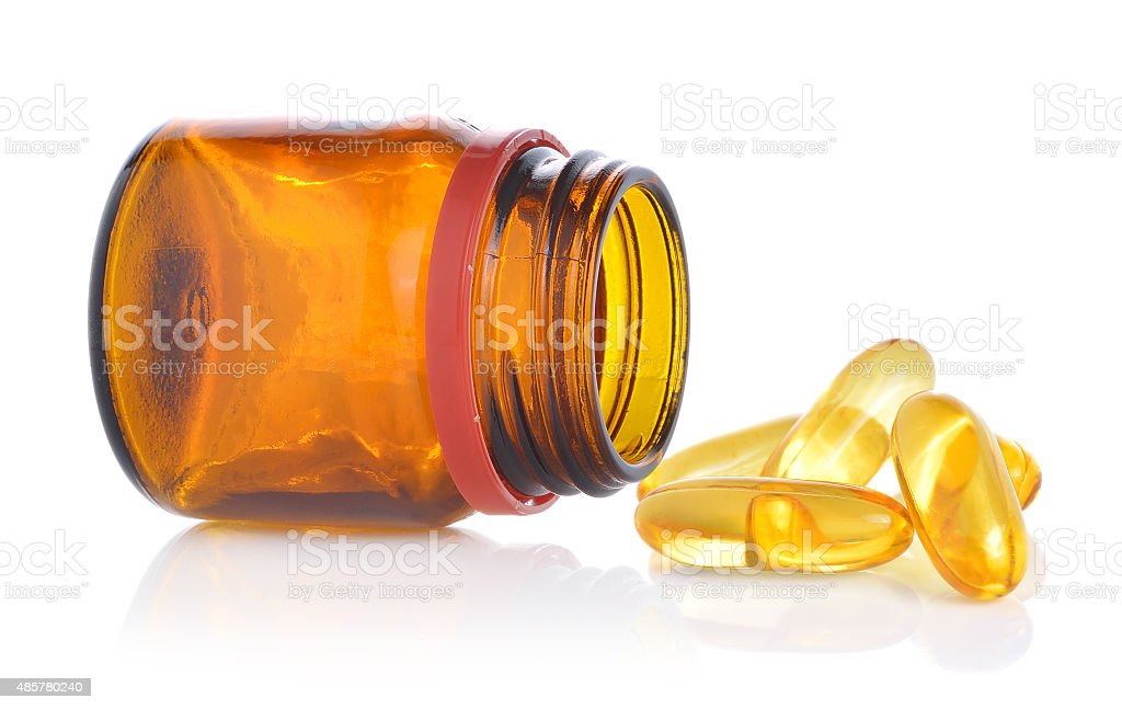 Fishoil pills out of bottle on white stock photo