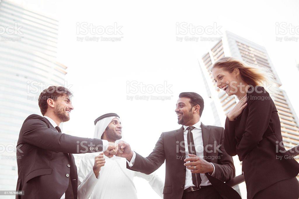 Fist bump between Collegues stock photo
