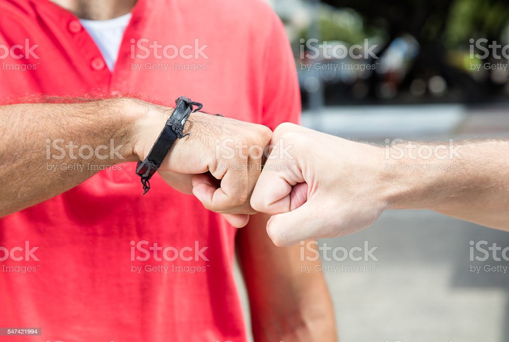 Fist bump of two guys stock photo