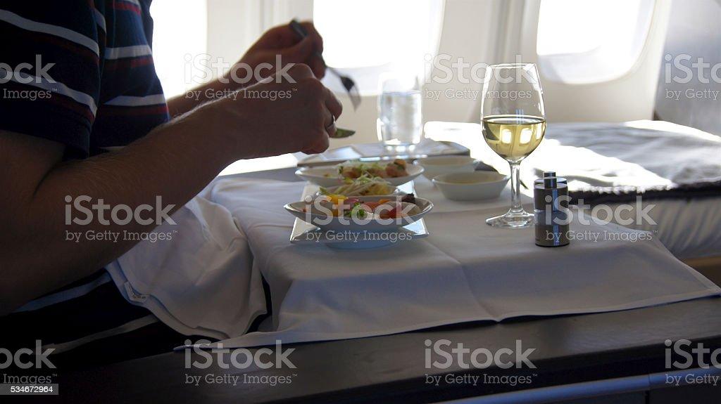 Fist Class - eatibg dessert onboard stock photo