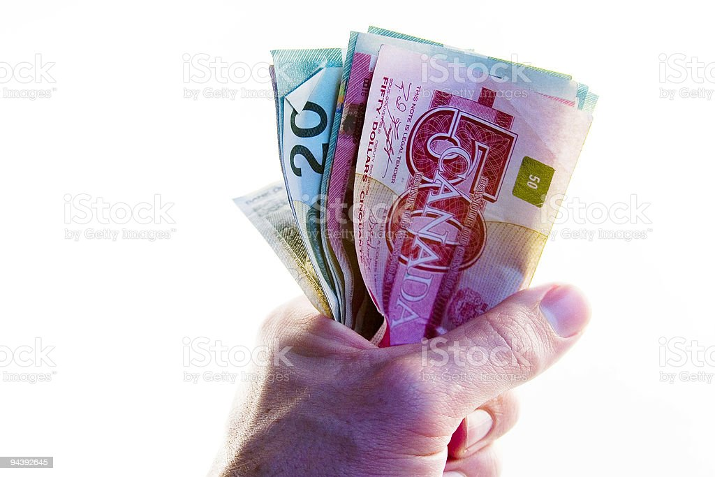 Fist full of Canadian Money stock photo