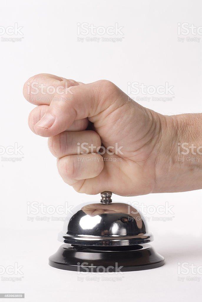 Fist hitting service bell stock photo