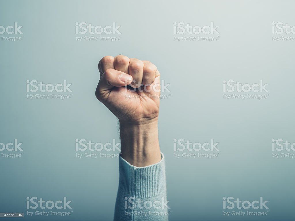 Fist in the air stock photo