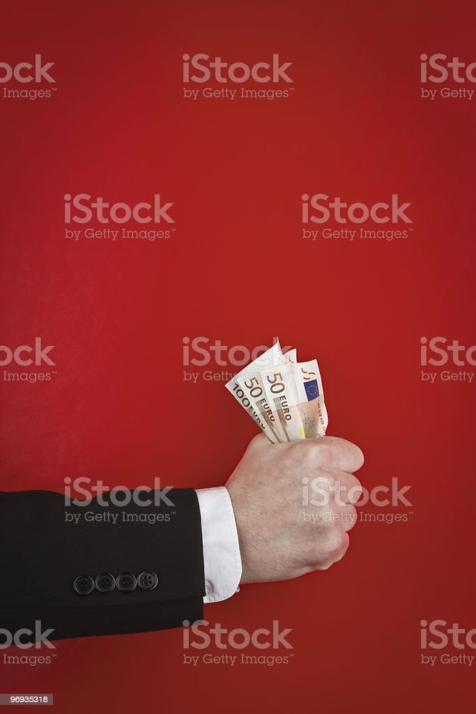 Fist of money royalty-free stock photo
