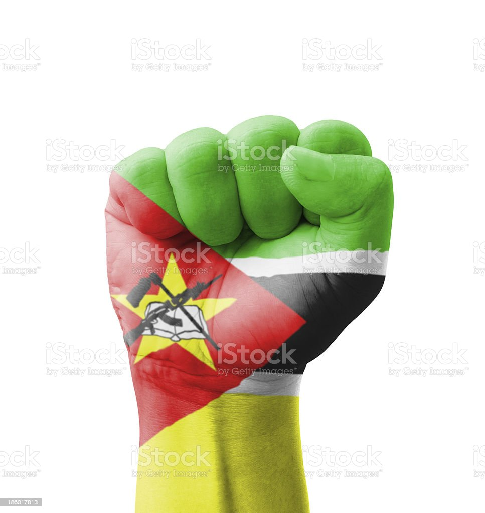 Fist of Mozambique flag painted, multi purpose concept stock photo