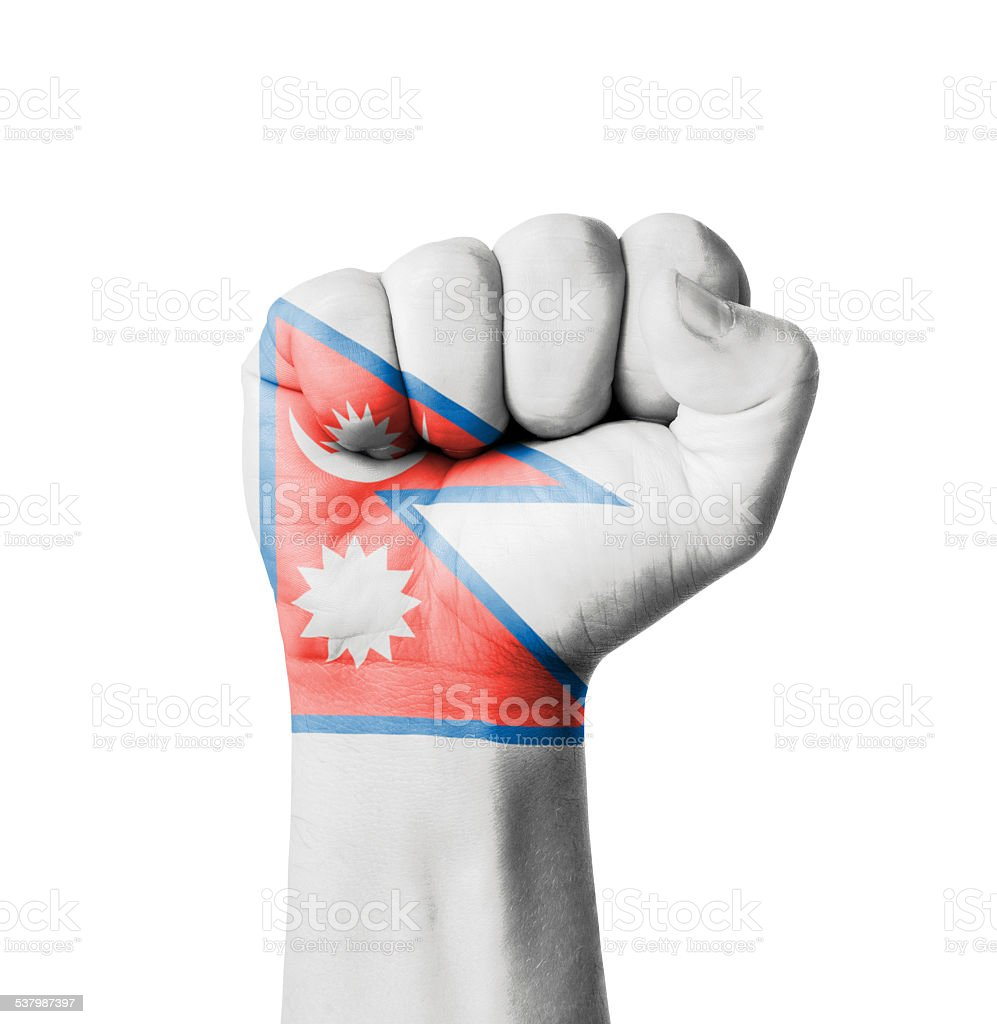 Fist of Nepal flag painted stock photo