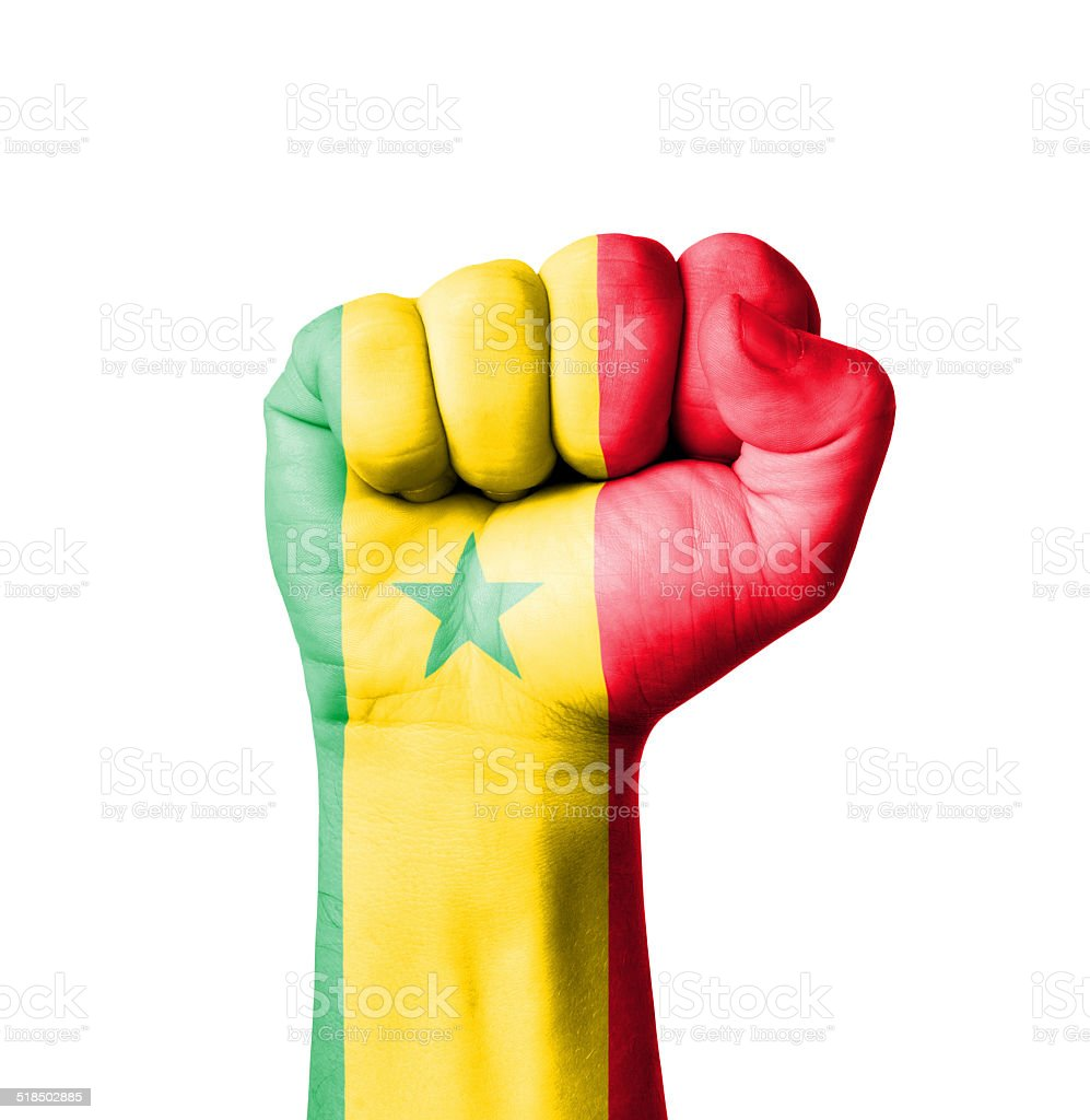 Fist of Senegal flag painted stock photo