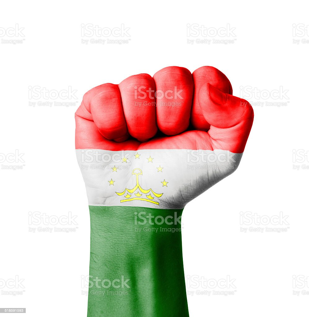 Fist of Tajikistan flag painted stock photo