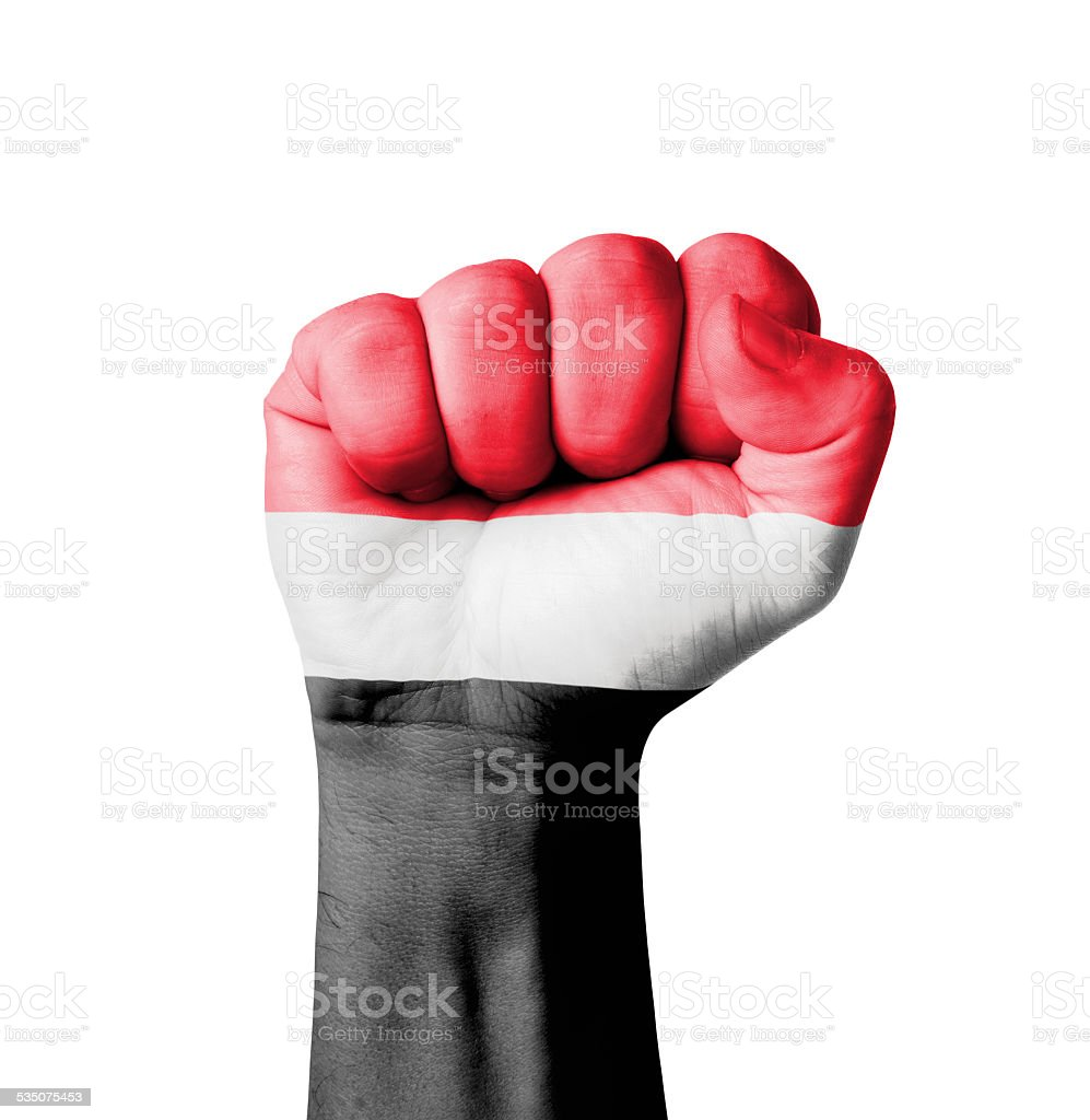 Fist of Yemen flag painted stock photo