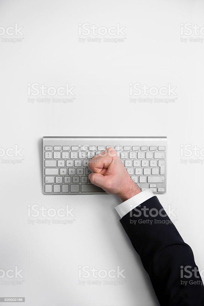 Fist On Computer Keyboard stock photo